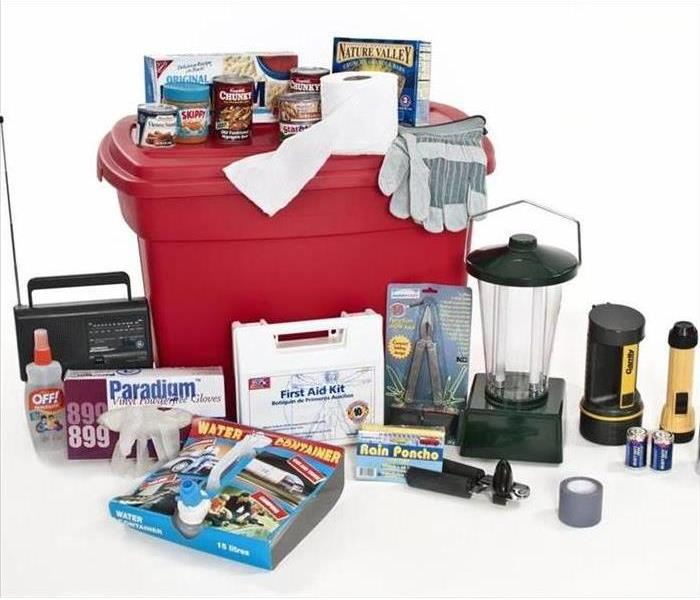 An emergency preparedness kit, with things like flashlights, first aid kit, and food and a radio.