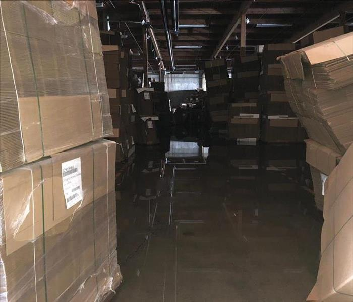A Warehouse of boxes with water covering the floor