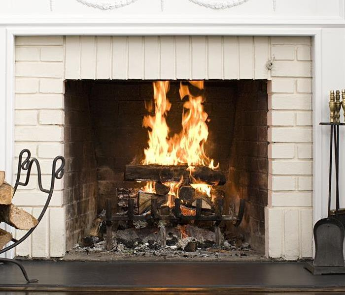 cozy brick fireplace with a fire burning